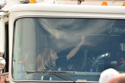Alexus pulling horn in truck